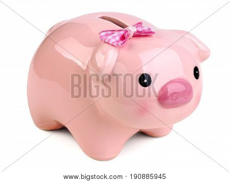 Funny female piggy bank wearing pink bow isolated over white background. Money saving home bookkeeping shopping and income concept