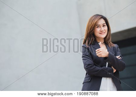 Asian Working Woman Thumb Up Or Business Girl Good Job With Building Architecture Background.