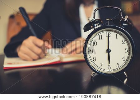 Time Working, Clock Times At 6 O'clock With Blur Women Business Work Writing Or Writer.