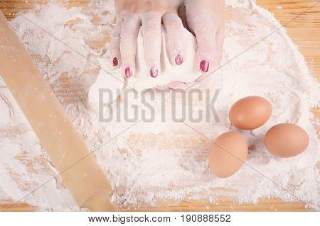 Woman Hands Kneading Dough.