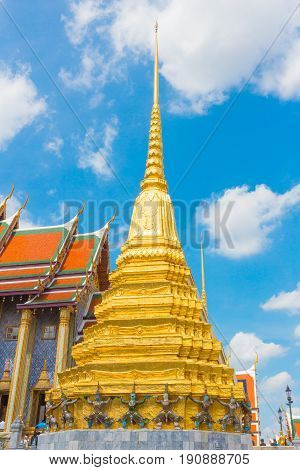 Beautiful golden pagoda in Thai temple with blue sky.
