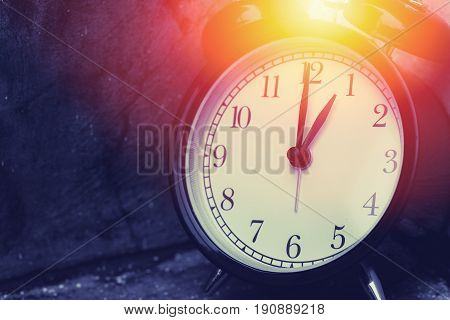 1 O'clock Vintage Clock At Dark Color Tone With Sun Light Memory Time Concept.