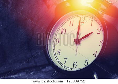 2 O'clock Vintage Clock At Dark Color Tone With Sun Light Memory Time Concept.