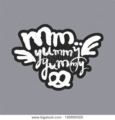 Mm Yummy Yummy. Hand written phrase in calligraphic style on gray background. White on black. Clipping paths included.