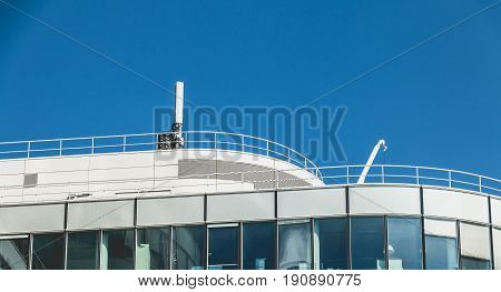 Cell phone antenna on the roof of a big building