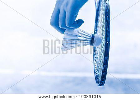 Badminton Sport Start Playing, Closeup Hand Serve Badminton Shuttlecock In Badminton Court.