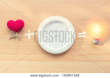 Love From Heart With Clock Time Can Bring New Idea Lighting The Bulb Concept.
