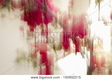 A White Abstract piece with red and green streaks