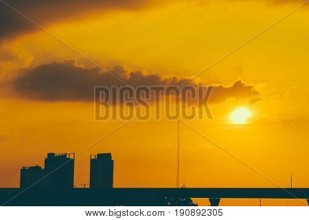Golden Orange Dusk Sky With Silhouette City Metro Urban Building Vintage Color Tone For Postcard Bac