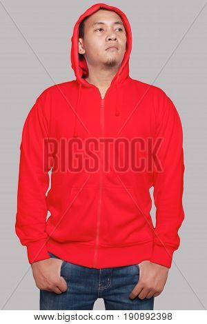 Blank sweatshirt mock up front view isolated on grey. Asian male model wear plain red hoodie mockup. Hoody design presentation. Jumper for print. Blank clothes sweat shirt sweater