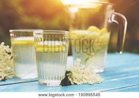 Two Glasses Of Elderflower Lemonade And Jug