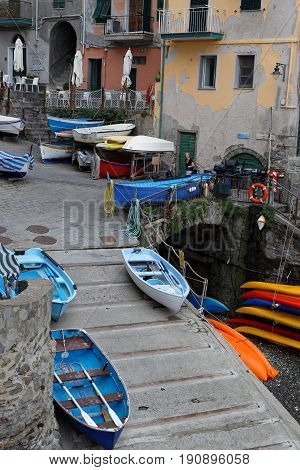 MANAROLA Italy June 4 2017 : Boats in the marina of a village of the Cinque Terre National Park on the Italian Riviera. The Cinque Terre area is a very popular tourist destination and a world heritage site.