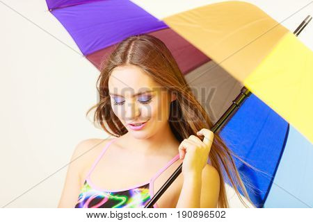 Woman Standing Under Colorful Rainbow Umbrella