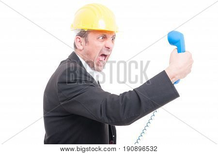 Side View Of Architect Yelling At Big Blue Telephone Receiver