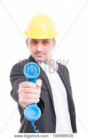 Selective Focus Of Architect Showing Big Blue Telephone Receiver