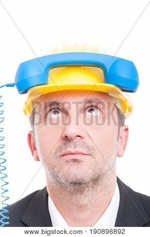 Close-up Of Architect Acting Silly With Telephone Receiver On His Head