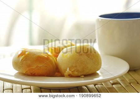Chinese pastry stuffed mashed bean and salty egg yolk with tea cup