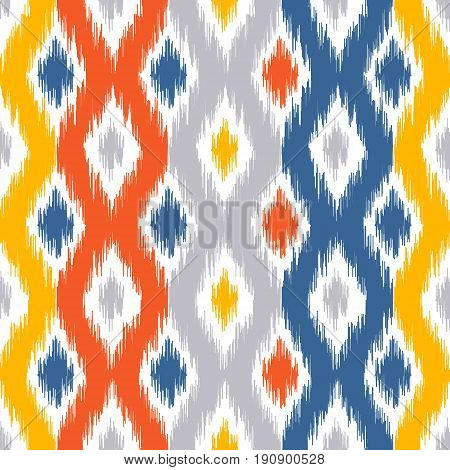 Seamless geometric pattern based on ikat fabric style. Vector illustration. Carpet rug texture vector imitation. Yellow red blue and grey ogee pattern.