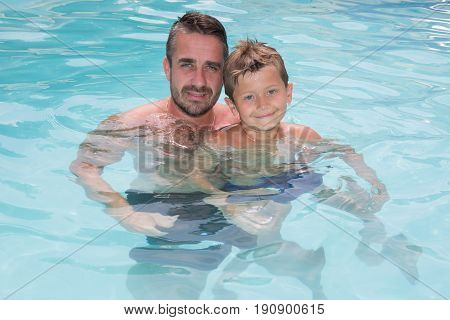 father and son happy in summer pool house