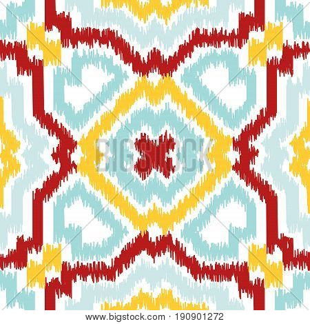 Seamless geometric pattern based on ikat fabric style. Vector illustration. Carpet rug texture vector imitation. Colorful rug pattern in yellow red turquoise mint and white.