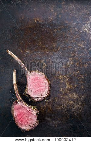 Barbecue Rack of Venison as top view on an old rusty metal sheet