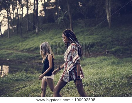 Women Walking by the Nature with Friends