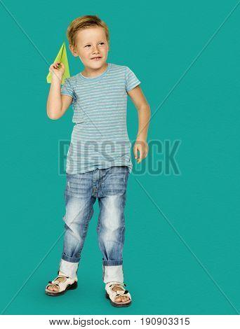 Caucasian Ethnicity Boy Launching Paper Plane