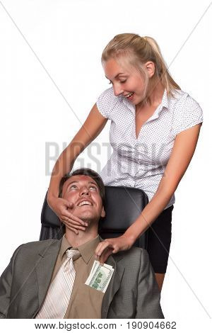 Pretty secretary pulls out money from a pocket of the businessman