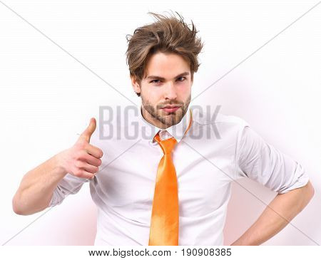 Bearded man short beard. Caucasian serious macho with moustache and ruffled hair have acid orange tie on white shirt isolated on white studio background office worker concept