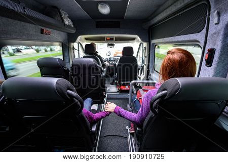 Family travelling in minivan to airport. People on public transport bus or van are travelling to airport for vacation. Aerodrome transfer service vehicle.
