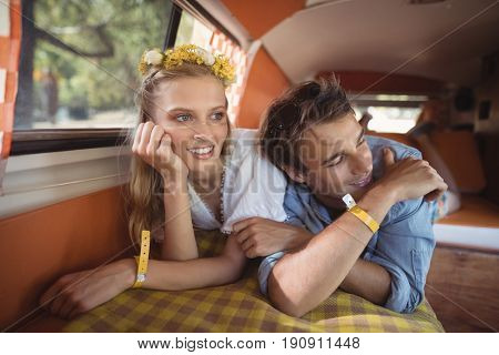 Young couple lying down in mini van