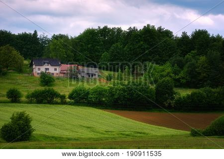 Rural alpine landscape with slovenian village in valley near Bled lake at spring sunny day. Slovenia.