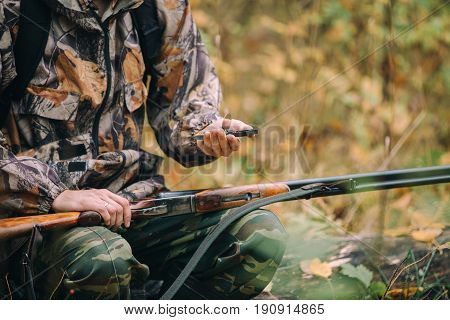 Hunter with compass. Classic vertical two barrels hunting rifle.