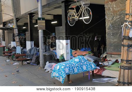 SYDNEY AUSTRALIA - MAY 31, 2017: Unidentified homeless people set up their beds at Martin Place in downtown Sydney.