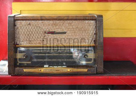 Vintage old retro Radio receiver 1960 yearon a motley background