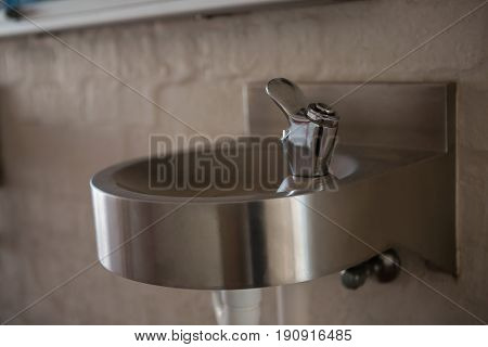 Close up of drinking water faucet on sink at school