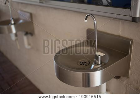 High angle view of drinking water faucet on sink at school