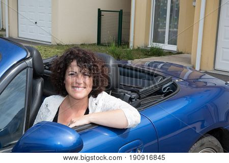 Forties Woman In Summer Car In Front Of Home House