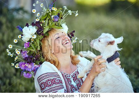 Funny picture a beautiful young girl farmer with a wreath on her
