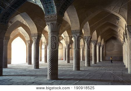SHIRAZ IRAN - SEPTEMBER 16 2014: Toddler boy playing in Vakil Mosque among columns of Shabestan. This religious place was built between 1751 and 1773 during reign of the Zand dynasty all over Iran.