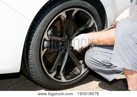 Man Technician Comes To Repair A Punctured Wheel