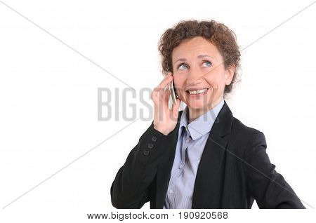 Beautiful smiling business woman talking on the phone. Business lady in dark suit is talking on the mobile phone and smiling, isolated on white