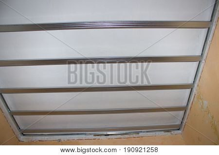 Metal construction on the ceiling for mounting drywall