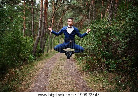 Crazy Groom Performing Tricks On His Wedding Day In The Middle Of Pine Forest.