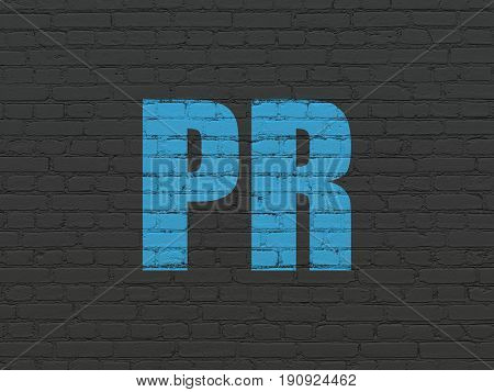 Advertising concept: Painted blue text PR on Black Brick wall background