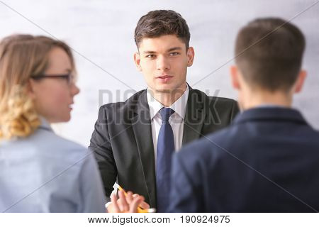 Human resources commission interviewing young man