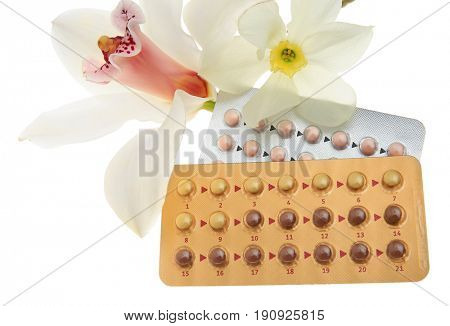 Oral contraception concept. Birth control pills and beautiful flowers on white background