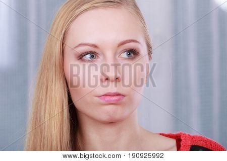 Portrait Of Blonde Woman With Serious Face Expression