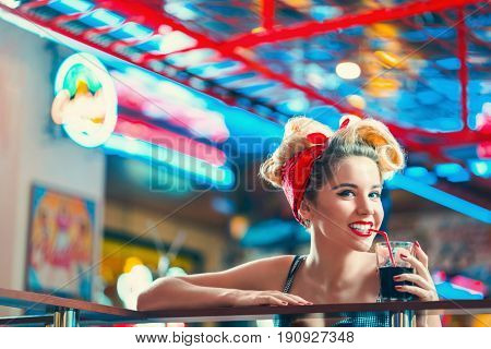 Smiling woman in retro cafe