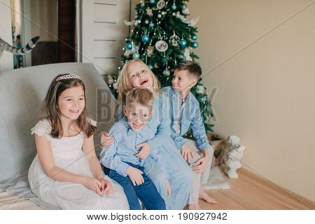 In the room near the New Year tree, children play in costumes